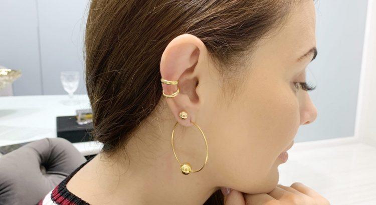 Banner ear bling